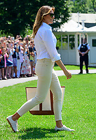 First lady Melania Trump walks on the South Lawn of the <br /> White House in Washington, DC to join United States President Donald J. Trump after he made remarks and answered reporter's questions as he prepares to depart on Friday, July 5, 2019.  The President will travel to Westminster, New Jersey for the weekend.<br /> CAP/MPI/RS<br /> ©RS/MPI/Capital Pictures