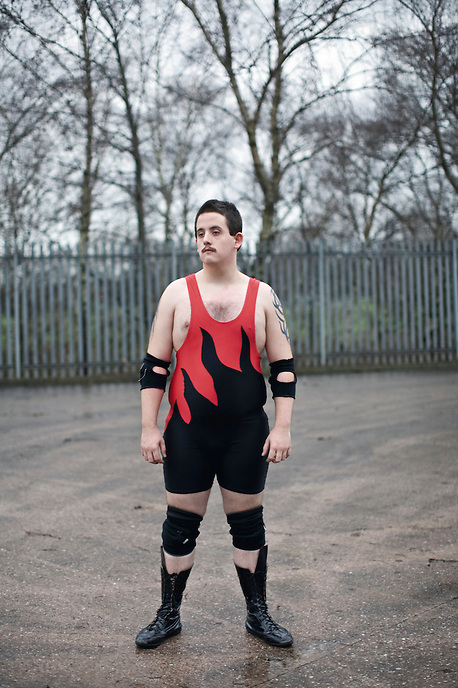 """21 year old Kyle is a Computer Science student and amateur wrestler from Stoke-on-Trent. """"Wrestling is a form of art, everything that you do is crafted. But if somebody gets hurt we don't call it art, we call it a mistake. I'm from Longton, I'd say it's a nice place to be, I'd say it's just right, but I don't like the traffic in the morning when I try and get to university. I'm thinking about starting a computer business when I leave uni, building them, fixing them, all that sort of stuff."""" The dramatic demise of once world-renowned industries has left a scarred landscape and relatively high levels of unemployment throughout Staffordshire. The consequence to the cultural identity of the town has been dramatic, giving rise to a whole new set of subcultures."""