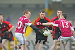 Colm O'Sullivan Kenmare is tackled by DJ O'Sullivan and Ian Guiney Rockchapel during their Munster Club Champiionship semi final in Fitzgerald Stadlium on Sunday