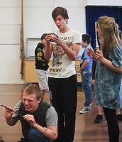 """Edmund"" receiving a gift of Turkish Delight from the ""Wicked Queen"".  The Yvonne Arnaud Youth Theatre rehearsing ""The Lion, the Witch and the Wardrobe"", Guildford, Surrey."