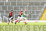 Sean Weir Crotta goes past Sean Spillane Kenmare/Kilgarvan during their semi final in Fitzgerald Stadium on Saturday
