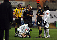 Pictured: Referee Steve Tanner (L) about to show Aron Gunnarsson (12) of Coventry City a yellow card for his foul against Jordi Gomez of Swansea City who is on the ground while Jason Scotland (R) and Leon McKenzie (2nd L) look on.<br /> Re: Coca Cola Championship, Swansea City FC v Coventry City at the Liberty Stadium. Swansea, south Wales, Friday 26 December 2008.<br /> Picture by D Legakis Photography / Athena Picture Agency, Swansea 07815441513