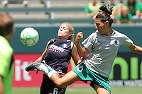 McCall Zerboni #6 of the Los Angeles Sol battles for control of the ball against Stephanie Logterman #3 of the St. Louis Athletica during their WPS game at The Home Depot Center on July 8,2009 in Carson, California.  St. Louis defeated the Los Angeles Sol 1-0.