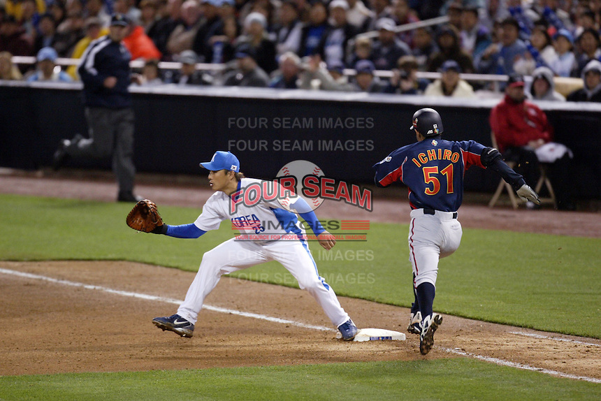 Seung-Yeop Lee of Korea and Ichiro Suzuki of Japan during the World Baseball Championships at Petco Park in San Diego,California on March 15, 2006. Photo by Larry Goren/Four Seam Images