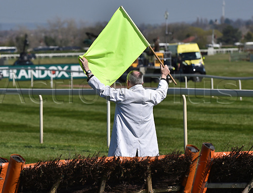 April 8th 2017, Aintree Racecourse, Liverpool, England; Randox Health Grand National Festival Horse racing, Grand National Day; Official holds up a flag ready for the Gaskells Handicap Hurdle to begin