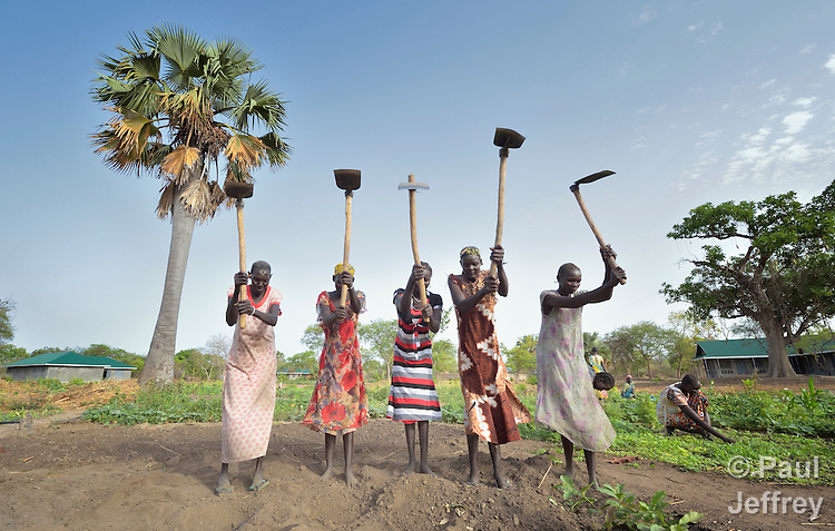 Women use hoes to prepare the ground for planting at the Multi Agricultural Jesuit Institute of Sudan (MAJIS), an agricultural school located outside Rumbek, South Sudan.