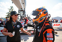 Sep 29, 2019; Madison, IL, USA; NHRA top fuel driver Mike Salinas (right) with wife Monica Salinas during the Midwest Nationals at World Wide Technology Raceway. Mandatory Credit: Mark J. Rebilas-USA TODAY Sports