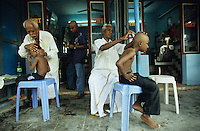 INDIA, Tamil Nadu, Vellankanni , roman catholic cathedral Our lady of good health , a holy pilgrimage place for christians , muslims , hindus as all expect wonder , ritual hair sacrifice ,  headshaving , the hair will be sold to factories which make artificial wig / INDIEN Tamil Nadu Vellankanni, roemisch katholische Kathedrale der Jungfrau Maria und einzigartiger Pilgerort fuer Christen Hindus Muslime , Wallfahrtsort und Glaube an Wunder , rituelle Kopfrasur Haaropfer , das Haar wird an Haarhaendler verkauft fuer kuenstliches Haar und Peruecken