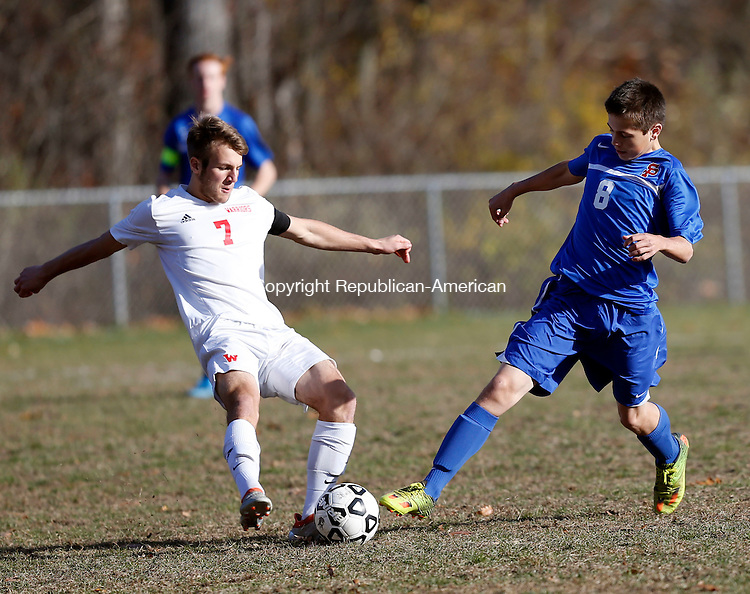 Litchfield, CT- 10 November 2016-111016CM02- Wamogo's Ryan DeLello left, goes in for the ball against St Paul's Mathew Stephani during their state tournament matchup on Thursday.     Christopher Massa Republican-American