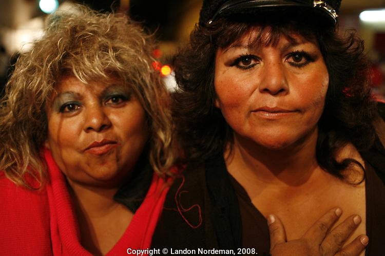 Puebla, Mexico - DEC 1: Two women outside the wrestling arena on Monday night December 1, 2008, in Puebla, Mexico. (Photo by Landon Nordeman)