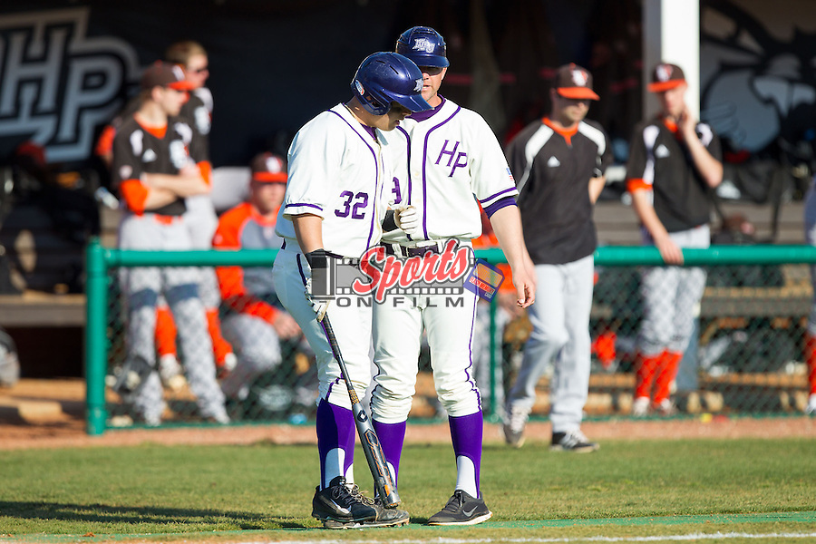 Dominic Fazio (32) of the High Point Panthers gets instructions from third base coach Rich Wallace (39) during the game against the Bowling Green Falcons at Willard Stadium on March 9, 2014 in High Point, North Carolina.  The Falcons defeated the Panthers 7-4.  (Brian Westerholt/Sports On Film)