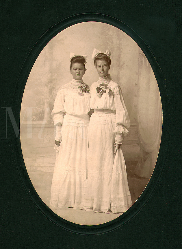 Annie and Stella pose together for family album, circa 1900-1910. Annie and Stella. Marble Falls, texas.