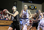 SIOUX FALLS, SD: MARCH 19:  Morgan Fleming #22 of Central Missouri drives past Tess Bruffey #54 of Lubbock Christian during their game at the 2018 Division II Women's Elite 8 Basketball Championship at the Sanford Pentagon in Sioux Falls, S.D. (Photo by Dick Carlson/Inertia)