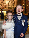 Calum Reilly from Scoil Aonghuasa who recieved First Holy Communion at St. Peter's church with sister Robyn. Photo:Colin Bell/pressphotos.ie