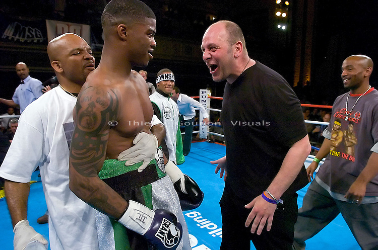 Promoter Lou DiBella (R) congratulates Jaidon Codrington (L) after his  8 rounds Super Middleweights Fight  against Etianne Whitaker  at the Hammerstein Ballroom in NYC on 04/28/2005..Codrington won by KO, 1 min 41s in the first round.