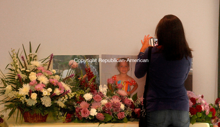 OXFORD, CT - 29 JULY 2017 - 072917JW11.jpg -- Neighbor of Chelsea Wheeler, Sylviane Lamore photographs a memorial to her during the celebration of her life Saturday at the Riverside Firehouse.  Jonathan Wilcox Republican-American