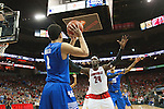 Guard Devin Booker of the Kentucky Wildcats passes the ball in during the game against  the Louisville Cardinals at KFC Yum! Center on Saturday, December 27, 2014 in Louisville `, Ky. Kentucky defeated Louisville 58-50. Photo by Michael Reaves | Staff