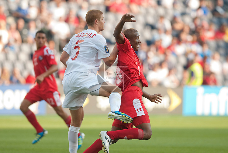 14 June 2011                         Canada defender Andre Hainault (5) collides with Panama attacker Luis Rentería (16) in the first half.  The Panama Men's National Soccer Team played against the Canada Men's National Soccer Team in the first qualifying round of the CONCACAF Gold Cup game at Livestrong Sporting Park in Kansas City, KS on June 14, 2011.