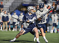 Washington, DC - February 27, 2018: Mt. St. Mary's Mountaineers Chris DiPretoro (24) attempts a shot while Georgetown Hoyas Stephen MacLeod (48) defends during game between Mount St. Mary's and Georgetown at  Cooper Field in Washington, DC.   (Photo by Elliott Brown/Media Images International)