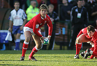 Welsh scrum half Rhys Williams moves play wide during the Division A clash against New Zealand at Ravenhill. Result New Zealand 37 Wales 14.