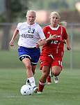 BROOKINGS, SD - AUGUST 16:  Caylee Costello #23 from South Dakota State University pushes the ball past Kayla Jacobsen #10 from Winnipeg in the first half of their game Friday evening at Fischback Soccer Field in Brookings. (Photo by Dave Eggen/Inertia)