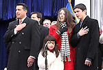 Nevada Gov. Brian Sandoval says the Pledge of Allegiance, which was led by his children Marisa, 6, Maddy, 14 and James, 15, during Monday's inauguration, Jan. 3, 2011 at the Capitol in Carson City, Nev. <br />
