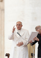 Papa Francesco benedice i fedeli al termine dell'udienza generale del mercoledi' in Piazza San Pietro, Citta' del Vaticano, 16 dicembre 2015.<br /> Pope Francis blesses the faithful at the end of his weekly general audience in St. Peter's Square at the Vatican, 16 December 2015.<br /> UPDATE IMAGES PRESS/Isabella Bonotto<br /> <br /> STRICTLY ONLY FOR EDITORIAL USE<br /> <br /> *** ITALY AND GERMANY OUT ***