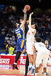 Real Madrid's Gustavo Ayon and UCAM Murcia's Faverani during the first match of the playoff at Barclaycard Center in Madrid. May 27, 2016. (ALTERPHOTOS/BorjaB.Hojas)