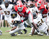 The Georgia Bulldogs beat the App State Mountaineers 45-6 in their homecoming game.  After a close first half, UGA scored 31 unanswered points in the second half.  Georgia Bulldogs defensive end Ray Drew (47) sacks Appalachian State Mountaineers quarterback Kameron Bryant (5)