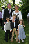 Niall McGinnity made his First Communion in Sandpit on Saturday, pictured here with mam and dad Ruth and Ambrose and sister and brother Laura and Connor.