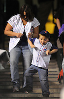 "16 APRIL 2011:  A young Chicago Cubs fan and his mother dance a jig to the song ""Cotton-Eye Joe"" during a pitching change during a regular season game between the Chicago Cubs and the Colorado Rockies at Coors Field in Denver, Colorado. The Bubs beat the Rockies 8-3.   *****For Editorial Use Only*****"