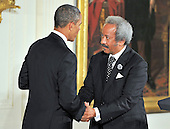 Allen Toussaint, right, shakes hands with United States President Barack Obama, left, prior to accepting the 2012 National Medal of Arts during the presentation ceremony in the East Room of the White House in Washington, D.C. on Wednesday, July 10, 2013.<br /> Credit: Ron Sachs / CNP