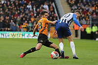 João Moutinho of Wolverhampton Wanderers takes Solly March of Brighton & Hove Albion during Wolverhampton Wanderers vs Brighton & Hove Albion, Premier League Football at Molineux on 7th March 2020