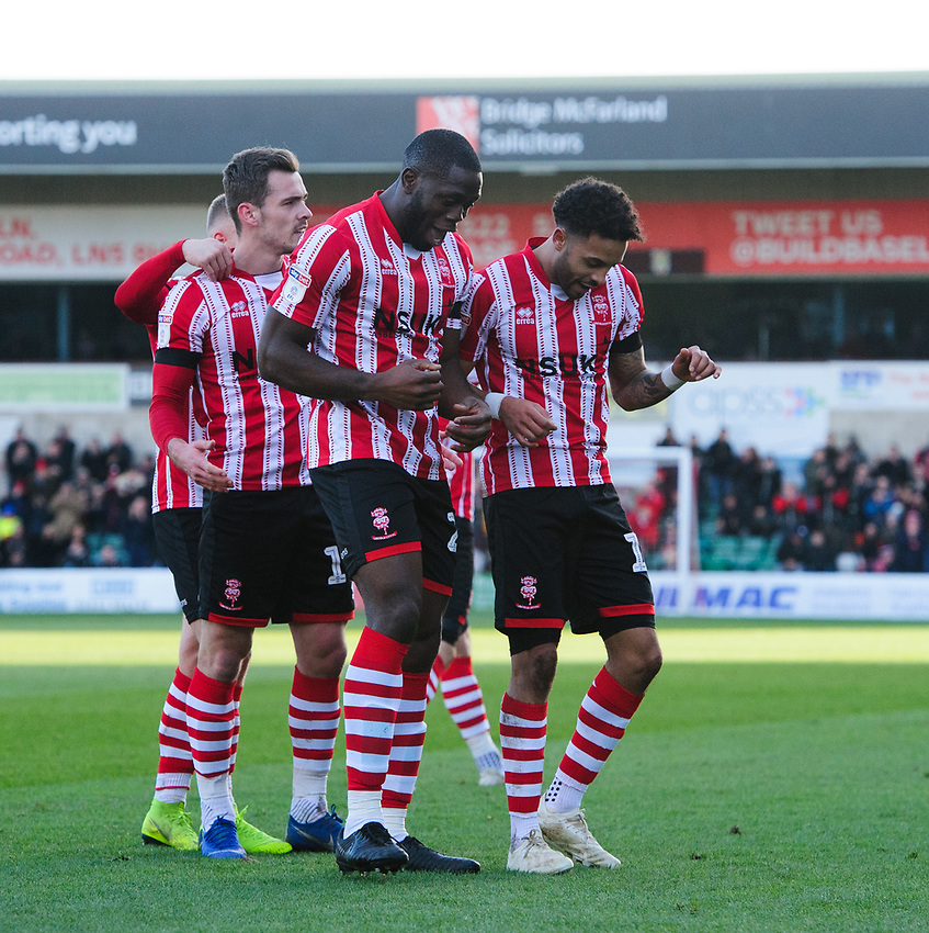 Lincoln City's Bruno Andrade, right, celebrates scoring the opening goal with team-mate John Akinde<br /> <br /> Photographer Chris Vaughan/CameraSport<br /> <br /> The EFL Sky Bet League Two - Lincoln City v Northampton Town - Saturday 9th February 2019 - Sincil Bank - Lincoln<br /> <br /> World Copyright © 2019 CameraSport. All rights reserved. 43 Linden Ave. Countesthorpe. Leicester. England. LE8 5PG - Tel: +44 (0) 116 277 4147 - admin@camerasport.com - www.camerasport.com