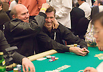 Bellagio Director of Poker Operations, Jack McLelland, kids around with Layne Flack.