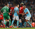 Paul Pogba of Manchester United clashes with Nicolas Otamendi of Manchester City during the premier league match at the Etihad Stadium, Manchester. Picture date 7th April 2018. Picture credit should read: Simon Bellis/Sportimage