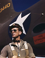 "Lieutenant F.W. ""Mike"" Hunter, Army pilot assigned to Douglas Aircraft Company, Long Beach, Calif. Photo by Alfred T. Palmer for the Office of War Information, October 1942."