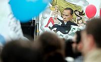"""Manifestazione dell'Italia dei Valori contro il Presidente del Consiglio e a sostegno dei referendum del 12 giugno contro nucleare, privatizzazione dell'acqua e legittimo impedimento, in piazza Navona, Roma, 19 marzo 2011..Italia dei Valori party's sympathizers wave flags during a """"No-Berlusconi"""" rally in Rome, 19 march 2011..UPDATE IMAGES PRESS/Riccardo De Luca"""