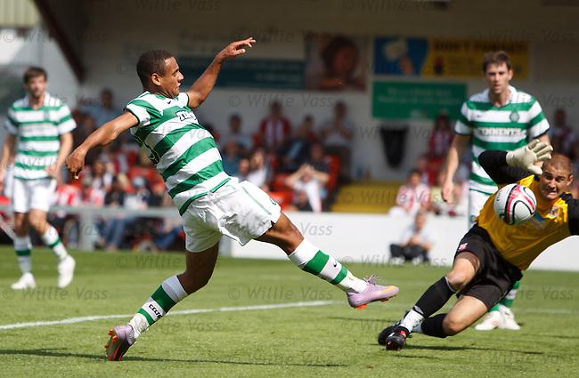 Ben Hutchinson scores Celtic's second goal past Lincoln keeper Joe Anyon
