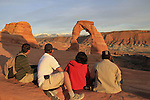 Family visits Delicate Arch in the morning at Arches National Park, Moab, Utah, USA. .  John offers private photo tours in Arches National Park and throughout Utah and Colorado. Year-round.