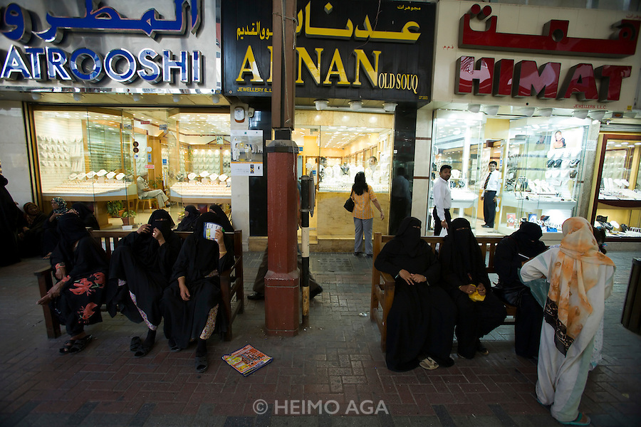 Deira. Gold Souq. Women in traditional dresses.