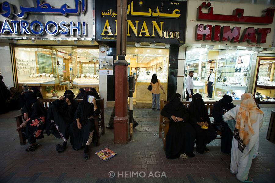 Deira. Gold Souq. Women in traditional dresses.