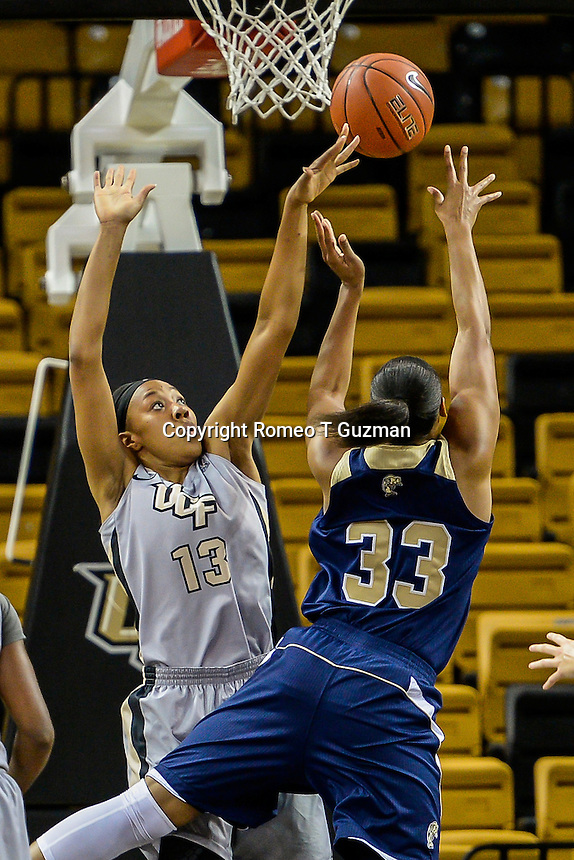 November 15, 2013 - Orlando, FL, U.S: UCF forward Brittni Montgomery (13) defends FIU forward/center Brianna Wright (33) under the basket during second half women's NCAA basketball game action between the FIU Panthers and the UCF Knights. UCF defeated FIU 71-66 at CFE Arena in Orlando, Fl.