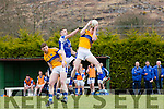 Kieran Murphy Glenflesk pulls the ball from the skies ahead of Templenoe Adrian Spillane during their Intermediate Championship clash in Glenflesk on Sunday