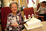 Louis McGowan cuts the cake to celebarte her 100th birthday at St. Ursula's Nursing Home in Bettystown Co. Meath. Photo: Andrew Spearman www.newsfile.ie