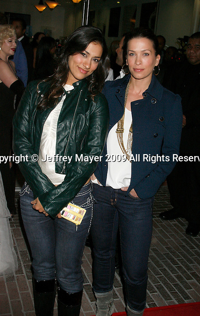 BEVERLY HILLS, CA. - October 07: Janina Gavankar and Christina Cox arrives at the Famous Cupcakes Beverly Hills Grand Opening Hosted By The Kardashian Family on October 7, 2009 in Beverly Hills, California..