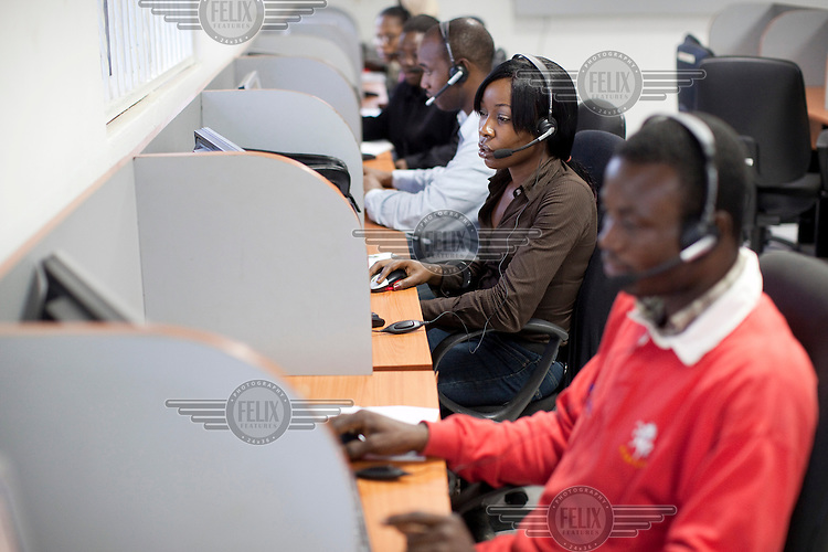 Workers at Nigerian satellite television provider Hi TV company's customer service call centre in Ikeja.