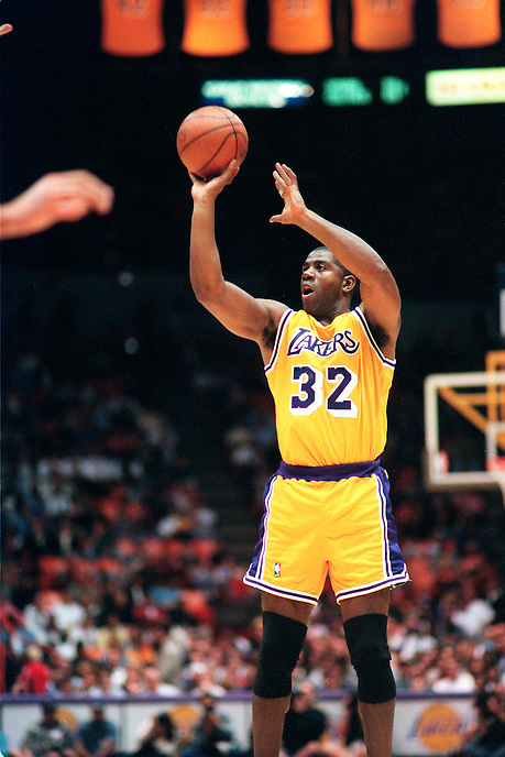 INGLEWOOD, UNITED STATES: Los Angeles Lakers Earvin 'Magic' Johnson plays in a game against the New Jersey Nets at the Great Western Forum in Inglewood, California in 1996. Johnson returned to the NBA after contracting HIV.