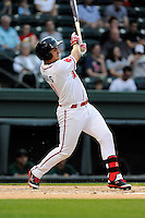 Designated hitter Michael Chavis (11) of the Greenville Drive bats in a game against the Augusta GreenJackets on Opening Day, Thursday, April 9, 2015, at Fluor Field at the West End in Greenville, South Carolina. Chavis was a first-round pick of the Boston Red Sox in the 2014 First-Year Player Draft. (Tom Priddy/Four Seam Images)