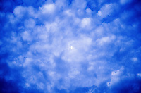 Blue fractal pattern in clouds around the moon.